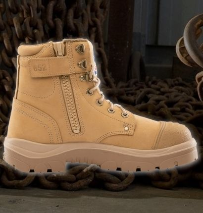 A sand colour boot with a dark industrial background.