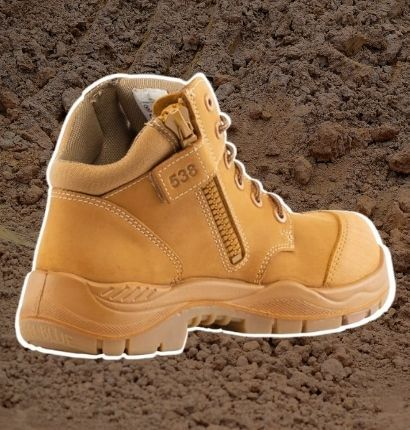 Boot with white highlight on dirt background