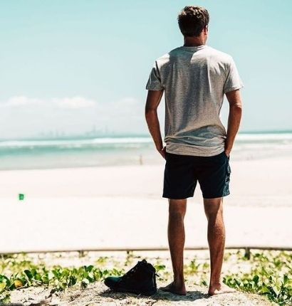 A man called Jacob standing on the beach on his holiday.